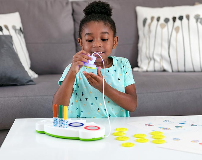 Young Girl Playing With Crayola Color Wonder Stamper