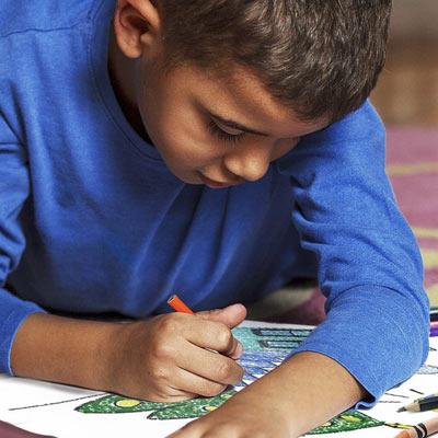 Young boy coloring Crayola Free Coloring Page