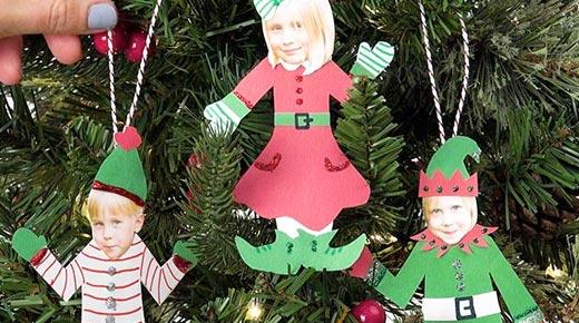 Homemade Elf Ornaments hanging on Christmas tree